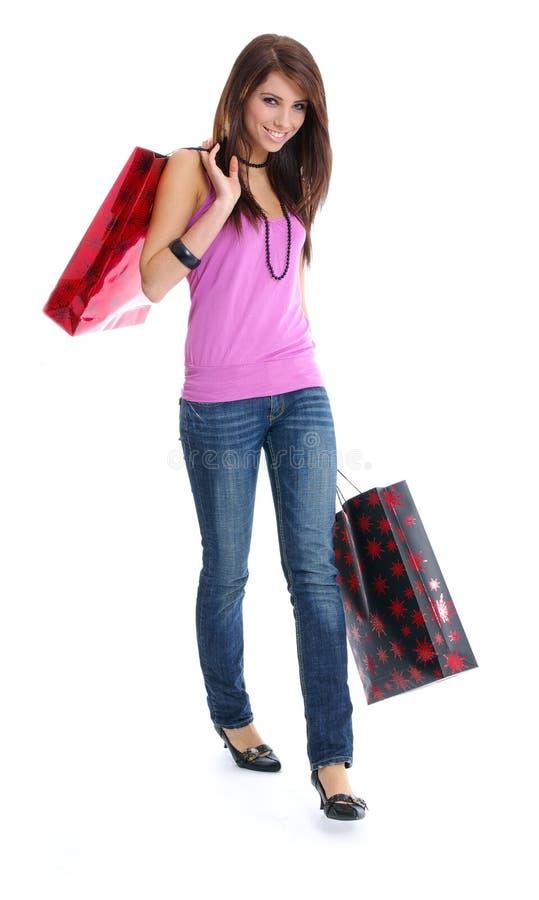 Reizvolle Frau mit Einkaufstasche lizenzfreies stockfoto
