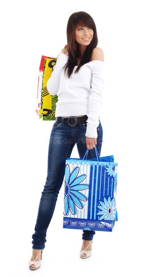 Reizvolle Frau mit Einkaufstasche stockfoto