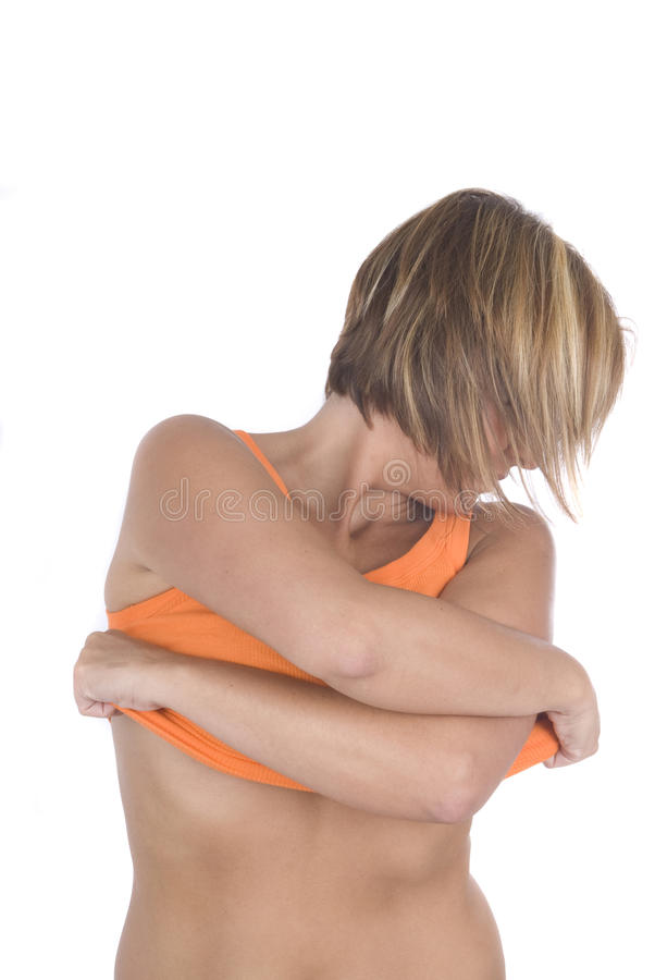 Reizvolle Frau mit Hemd in ihren Händen lizenzfreies stockbild