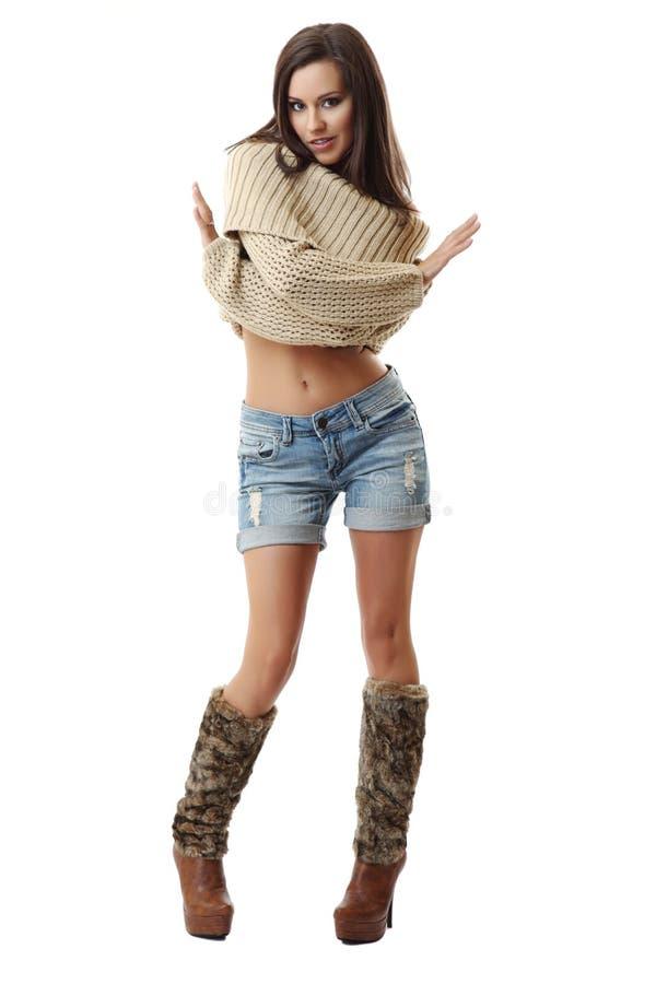 Reizvolle Frau zeigen ihren Bauch auf weißem Hintergrund lizenzfreie stockfotos