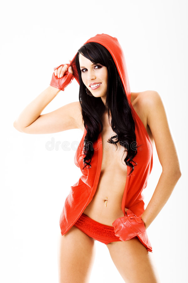 Reizvolle junge Dame im roten Kleid stockbild