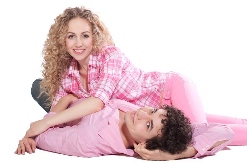 Reizvolle Paare getrennt auf Weiß stockbilder