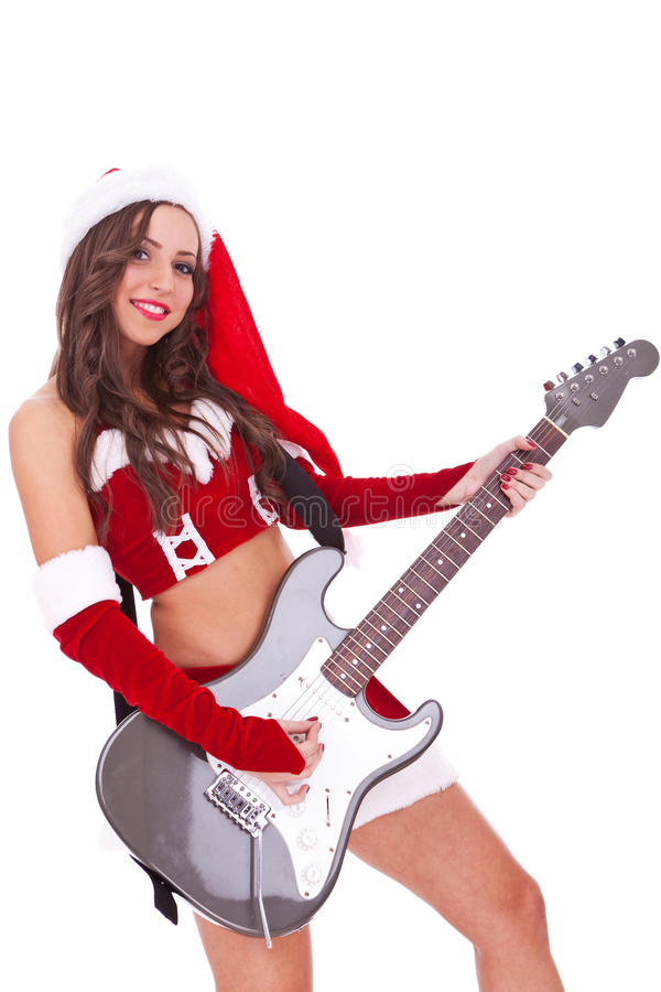 Reizvolle Sankt, die eine elektrische Gitarre spielt lizenzfreies stockbild