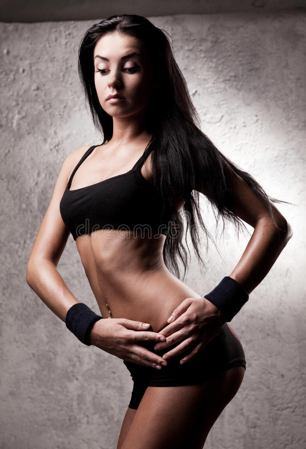 Reizvolle sportliche Frau lizenzfreies stockbild