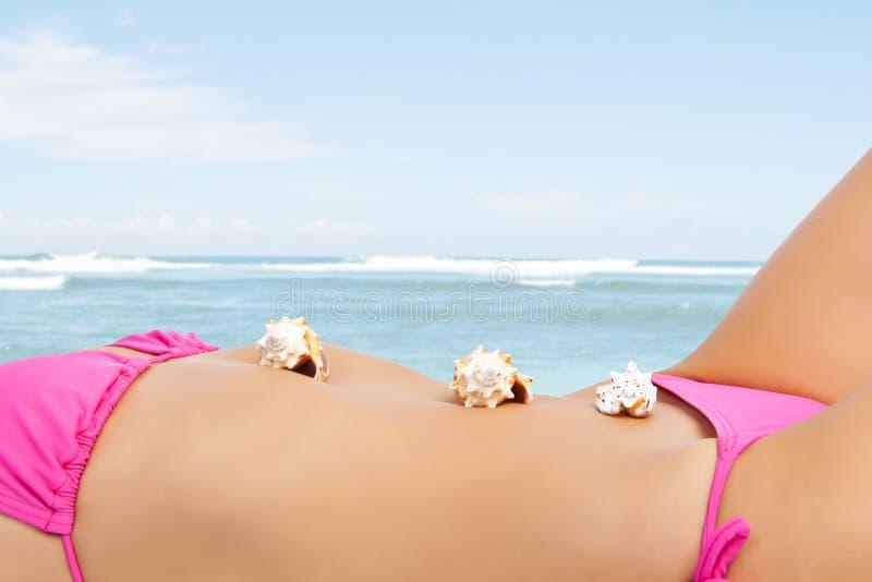 Reizvolle Strandfrau stockbilder
