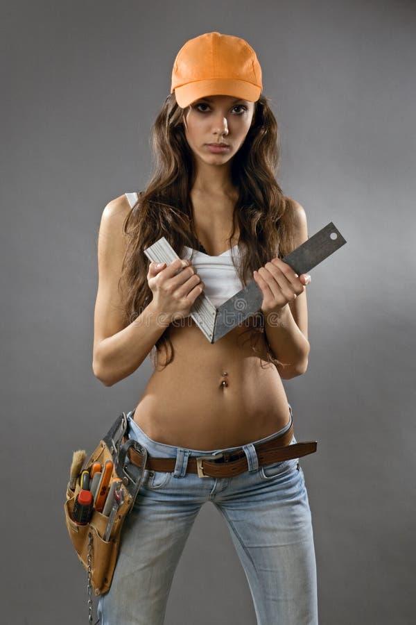 Reizvoller Bauarbeiter der jungen Frau stockbild