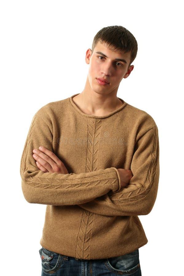 Reizvoller Mann im gelben Pullover stockbild