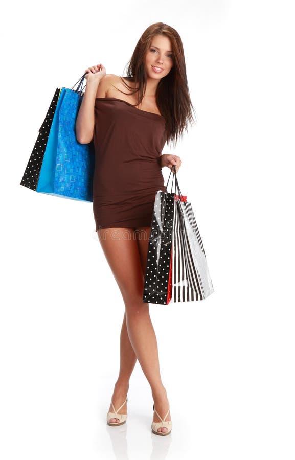 Reizvolles Einkaufenmädchen stockbilder