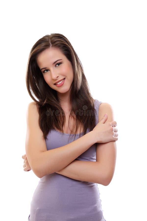 Reizvolles junges Brunettefrauenlächeln stockfoto