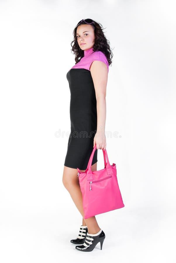 Reizvolles Mädchen im Kleid stockfoto