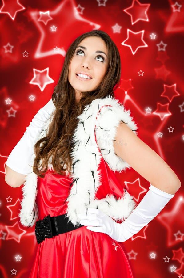Reizvolles Mädchen im Sankt-Kostüm lizenzfreies stockfoto
