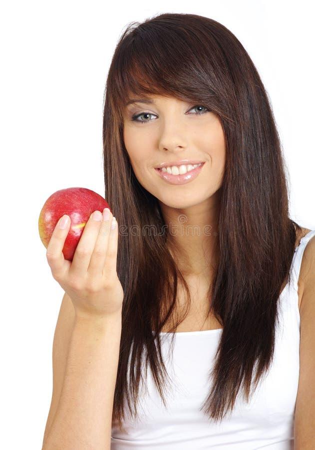 Reizvolles Mädchen mit Apfel lizenzfreie stockfotos