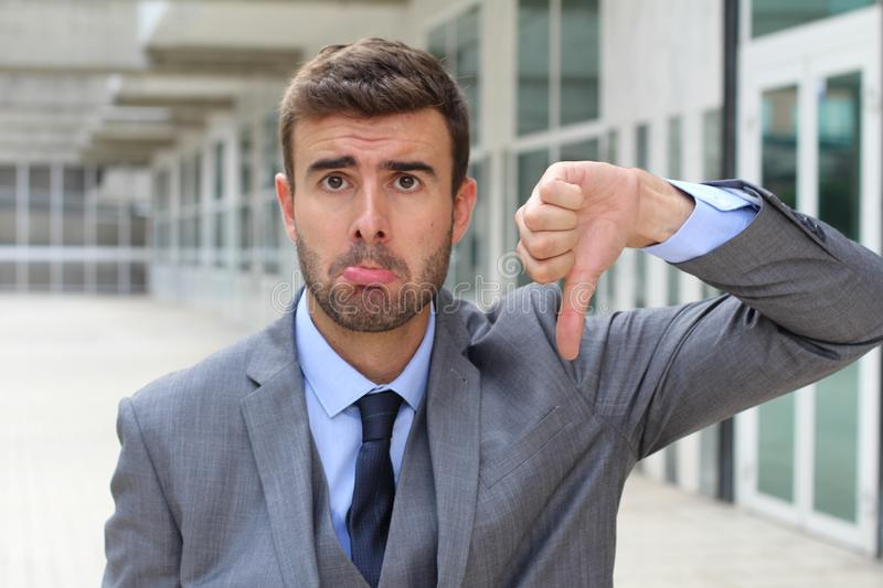 Rejected businessman whining in the office stock photo