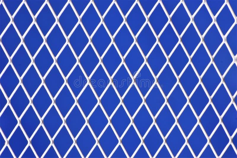 Rejilla en un fondo abstracto azul, bueno blancos para el diseño y la creatividad del día de fiesta Muchas formas geométricas for imagenes de archivo