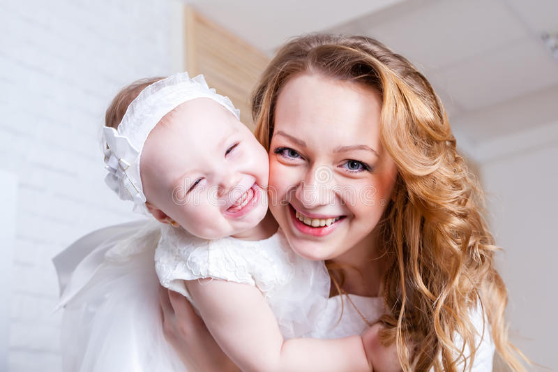 Rejoicing mom with her daughter stock photos