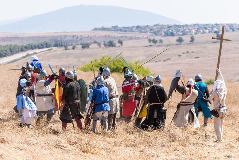 Rekonstruktion av horn av den Hattin striden i 1187 Infanteri för Saladin ` s slåss med infanterin av korsfararna på slagfältet arkivfoto