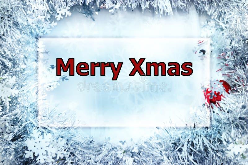 Rektangelram med glad Xmas-hälsning Inramat av den skinande snöflingan blänka royaltyfri foto