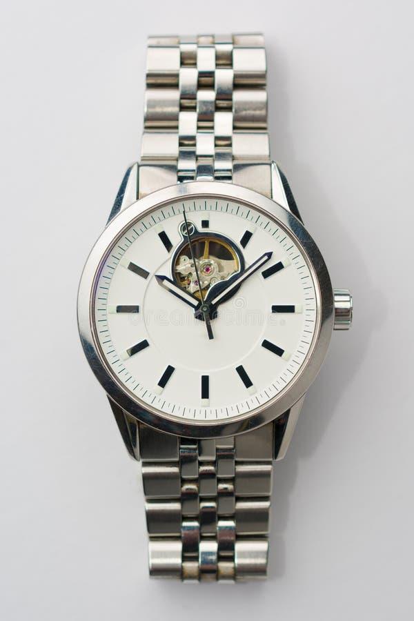 Relógio clássico do metal na opinião superior do fundo branco fotos de stock royalty free