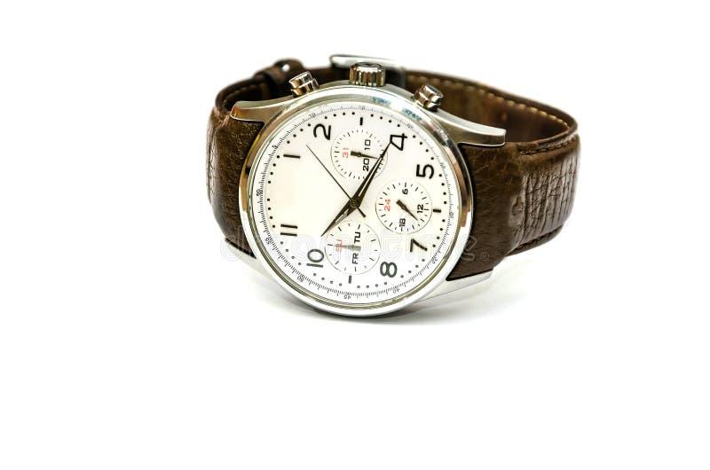 Relógio com um marrom, correia de couro em um fundo branco imagens de stock
