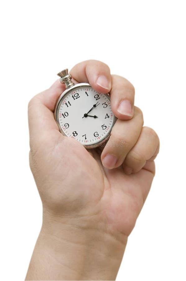 Relógio da terra arrendada da mão imagem de stock royalty free