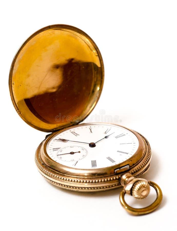 Relógio de bolso do ouro isolado no branco fotos de stock royalty free