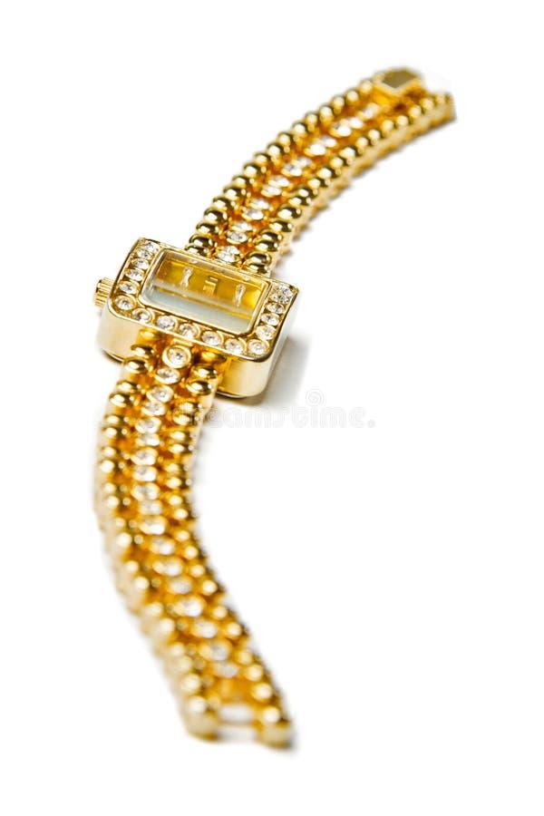 Relógio de pulso dourado com gemas fotografia de stock