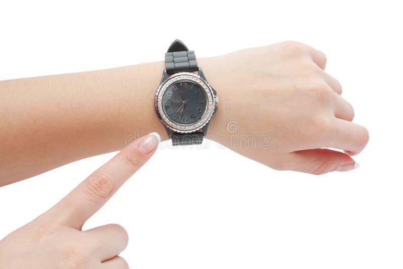 Relógio de pulso e a mão como um ponteiro fotografia de stock