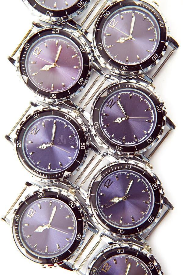 Relógios de pulso no fundo branco fotos de stock