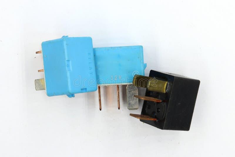Rel? elettrico, rel? ausiliario elettrico, rel? di potere della bobina, contattore magnetico, ricambio auto 12v isolato su fondo  fotografia stock