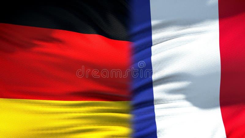 Relaciones del fondo de las banderas de Alemania y de Francia, diplomáticas y económicas imagenes de archivo