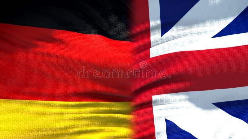 Relaciones del fondo de las banderas de Alemania y de Gran Bretaña, diplomáticas y económicas fotografía de archivo