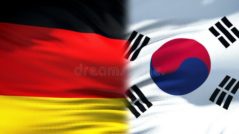 Relaciones del fondo de las banderas de Alemania y de la Corea del Sur, diplomáticas y económicas imagenes de archivo