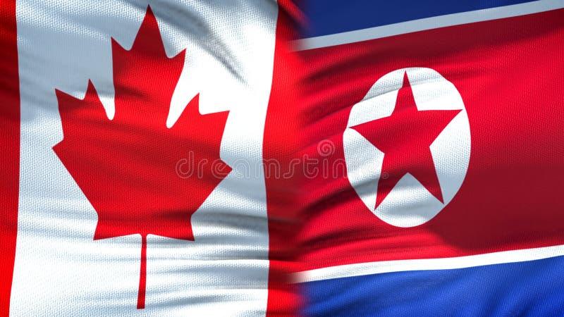 Relaciones del fondo de las banderas de Canadá y de Corea del Norte, diplomáticas y económicas imagen de archivo