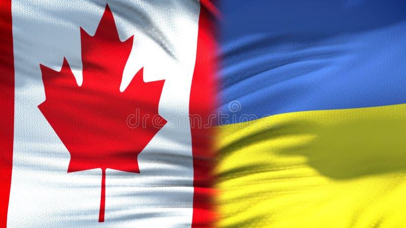 Relaciones del fondo de las banderas de Canadá y de Ucrania, diplomáticas y económicas, finanzas foto de archivo libre de regalías