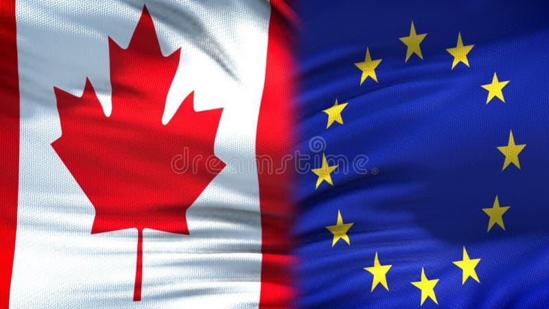 Relaciones del fondo de las banderas de Canadá y de unión europea, diplomáticas y económicas fotografía de archivo libre de regalías