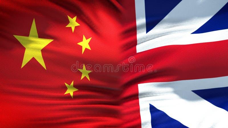 Relaciones del fondo de las banderas de China y de Gran Bretaña, diplomáticas y económicas imagen de archivo libre de regalías