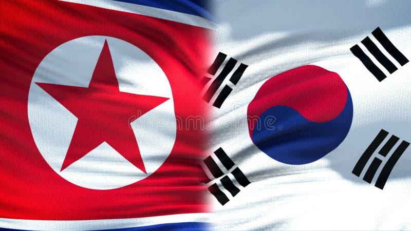 Relaciones del fondo de las banderas de Corea del Norte y de la Corea del Sur, diplomáticas y económicas foto de archivo libre de regalías