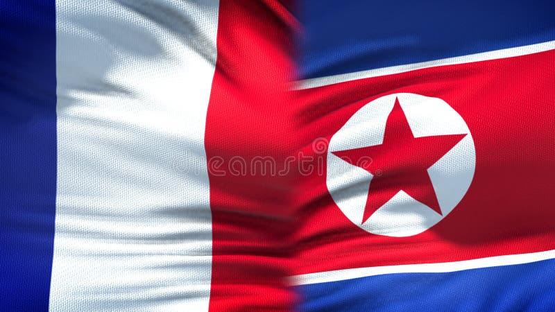 Relaciones del fondo de las banderas de Francia y de Corea del Norte, diplomáticas y económicas fotos de archivo