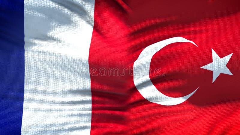 Relaciones del fondo de las banderas de Francia y de Turquía, diplomáticas y económicas, finanzas imagenes de archivo