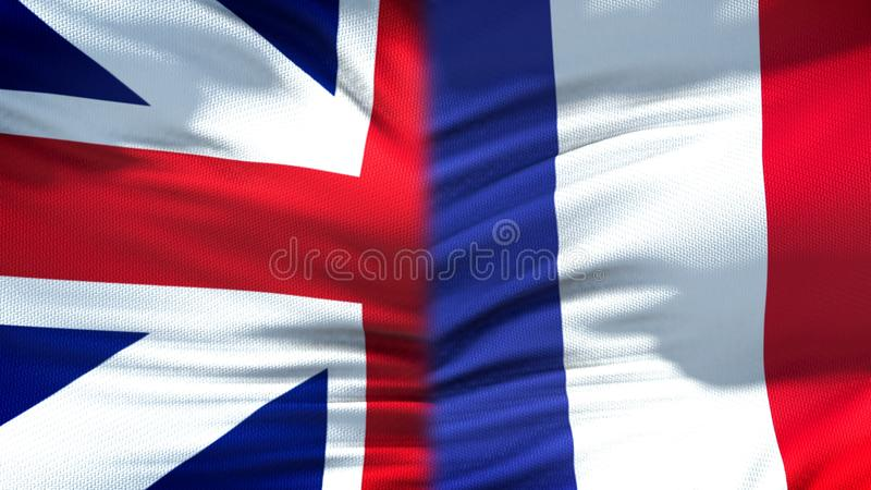 Relaciones del fondo de las banderas de Gran Bretaña y de Francia, diplomáticas y económicas imagenes de archivo