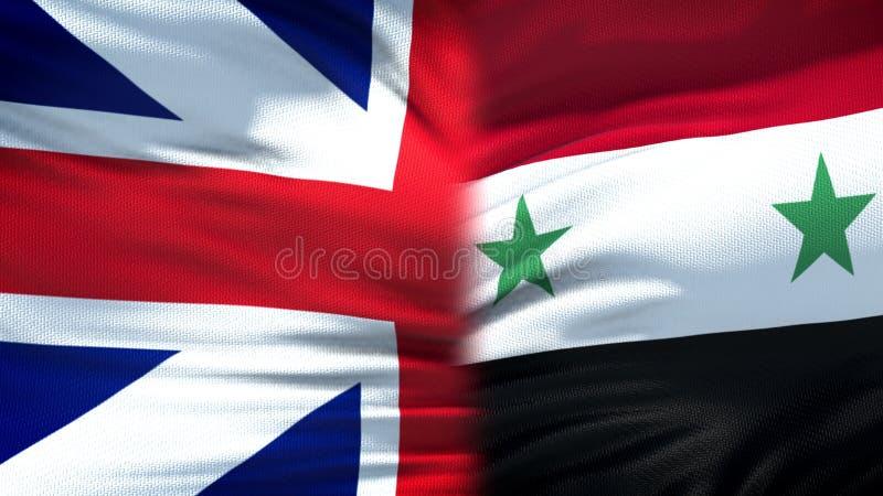 Relaciones del fondo de las banderas de Gran Bretaña y de Siria, diplomáticas y económicas imagen de archivo