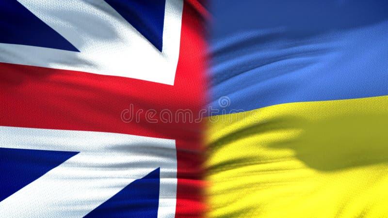 Relaciones del fondo de las banderas de Gran Bretaña y de Ucrania, diplomáticas y económicas imagen de archivo libre de regalías