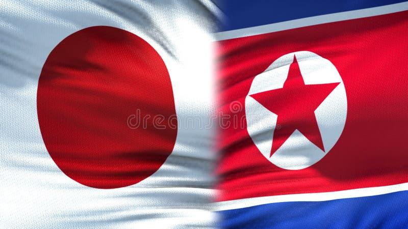 Relaciones del fondo de las banderas de Japón y de Corea del Norte, diplomáticas y económicas imagenes de archivo