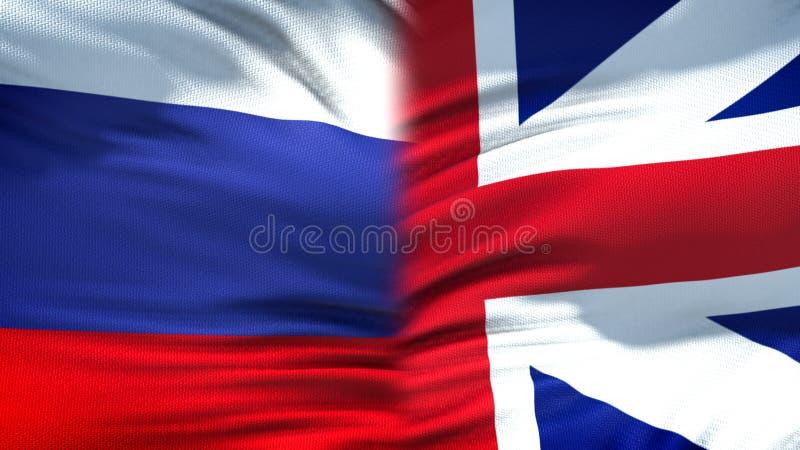 Relaciones del fondo de las banderas de Rusia y de Gran Bretaña, diplomáticas y económicas imagen de archivo libre de regalías