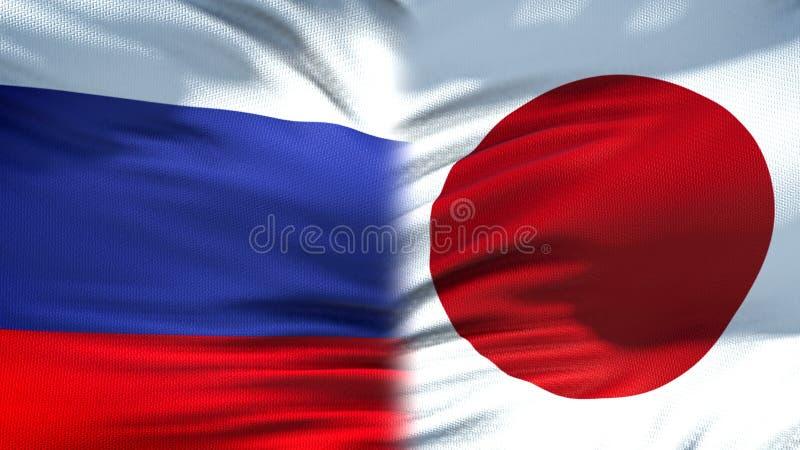 Relaciones del fondo de las banderas de Rusia y de Japón, diplomáticas y económicas, comercio foto de archivo libre de regalías