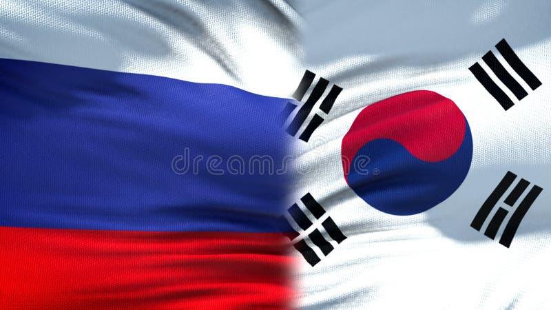 Relaciones del fondo de las banderas de Rusia y de la Corea del Sur, diplomáticas y económicas imagenes de archivo