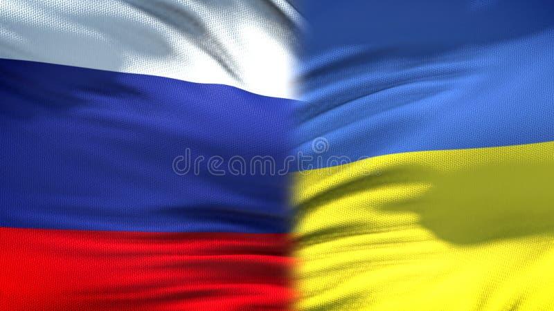 Relaciones del fondo de las banderas de Rusia y de Ucrania, diplomáticas y económicas, finanzas foto de archivo libre de regalías