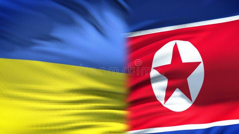 Relaciones del fondo de las banderas de Ucrania y de Corea del Norte, diplomáticas y económicas foto de archivo libre de regalías
