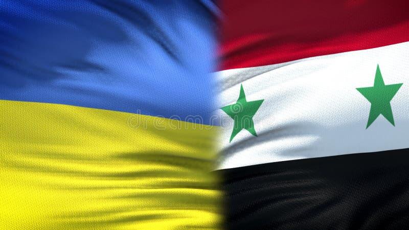 Relaciones del fondo de las banderas de Ucrania y de Siria, diplomáticas y económicas, seguridad imagen de archivo