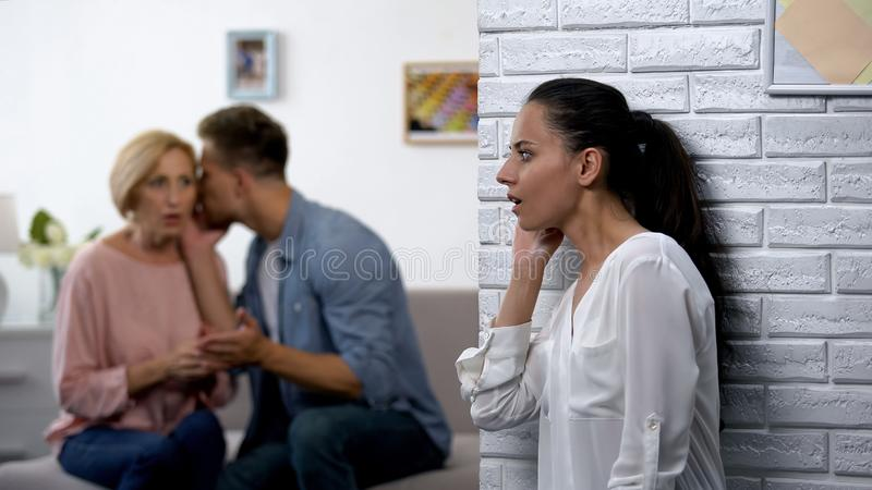 Relations problem, lady overhearing husband complaining on marriage to mother. Stock photo stock image